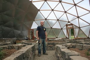Public Social University President Rozzell Medina in Geodesic Dome Greenhouse
